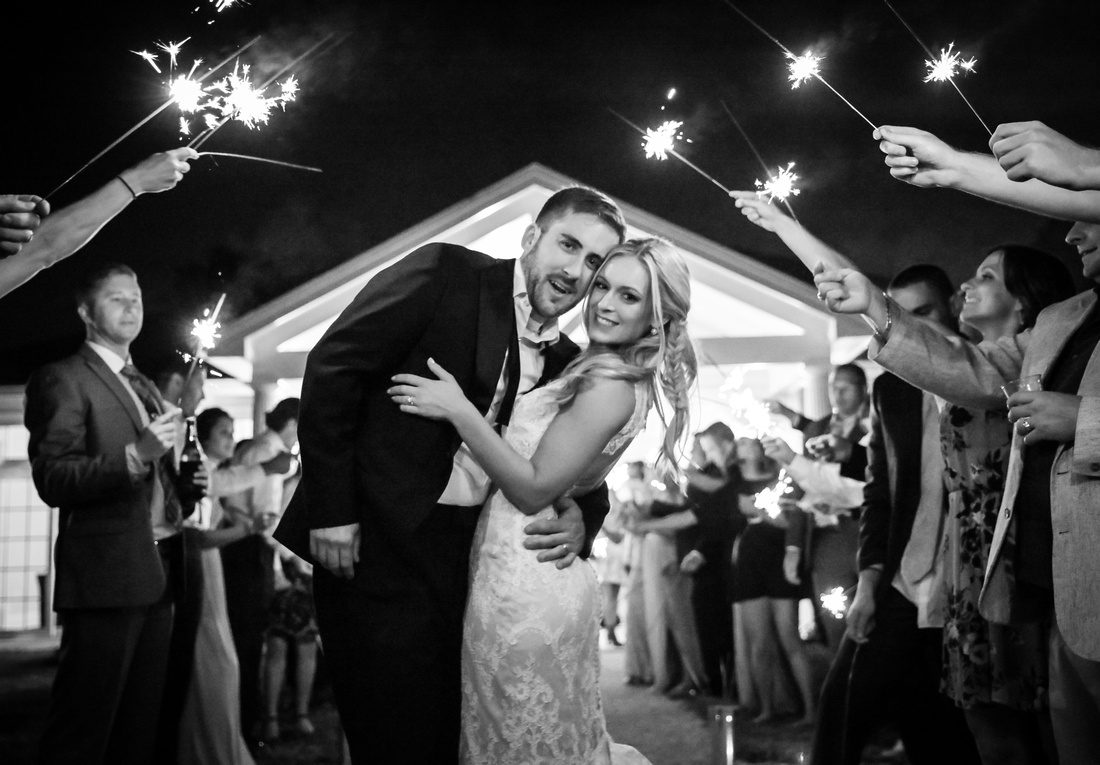 wedding sendoff with sparklers in black and white