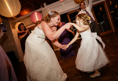 Wedding photography, the bride dances with a small flower girl.