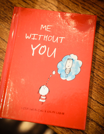 "Wedding photography, a shiny red book, ""Me Without You."""