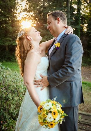 Wedding photography, the bride and groom stare in each other's eyes at sunset.