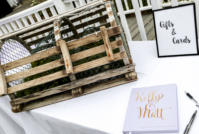 Wedding photography, the gift table has a nautical theme with a lobster trap for cards.