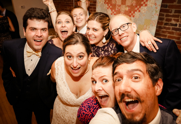 Wedding photography, the wedding party takes a selfy with their photographers.