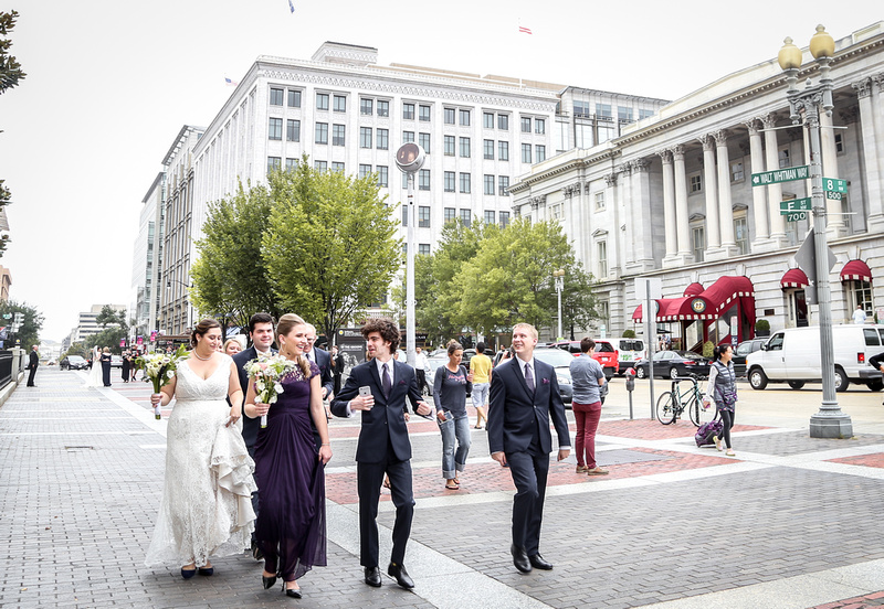 Wedding photography, a wedding party walks through the streets of DC.