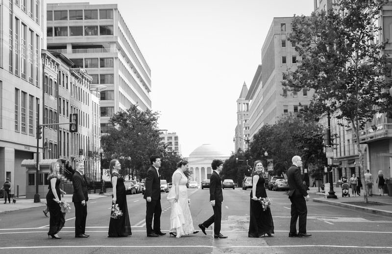 Wedding photography, a wedding party crosses a crosswalk in DC.