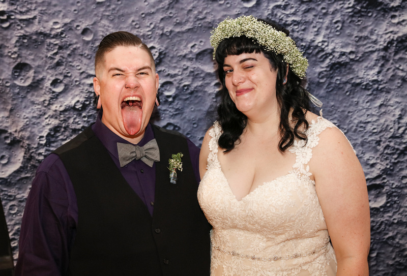 Wedding photography, a bride and groom make silly faces at their photo booth.