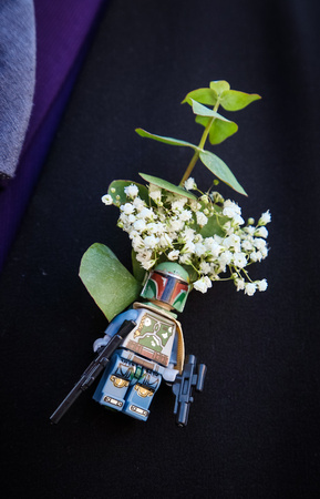 Wedding photography, a Star Wars boutonniere pin with babies' breath.