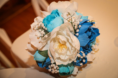 Wedding photography, a bouquet of blue and white paper flowers.