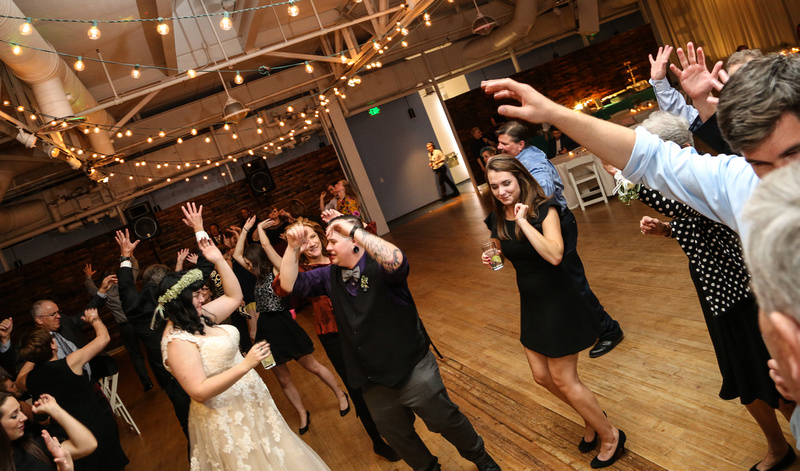 Wedding photography, the bride and groom dance and celebrate with their friends.