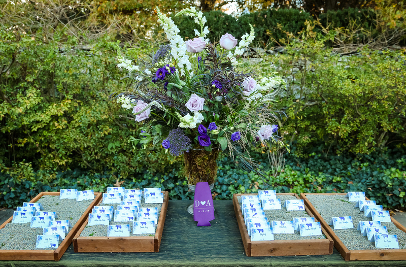 Wedding photography, the table place cards laying in displays of lavender.