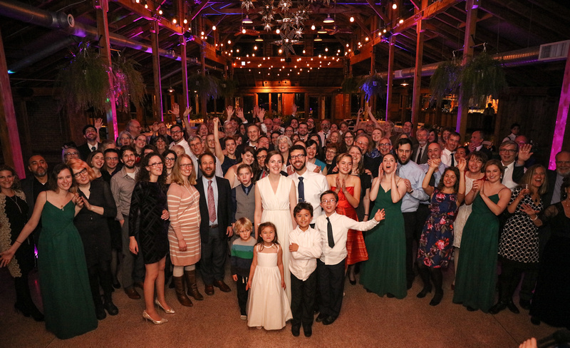 Wedding photography, a bride and groom pose with all of their wedding guests.