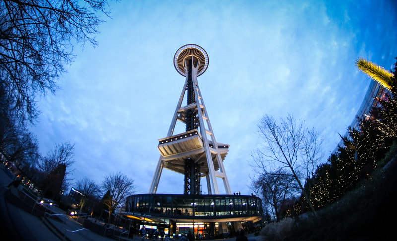 Wedding photography, fisheye lens photo of the Seattle Space Needle at nighttime.