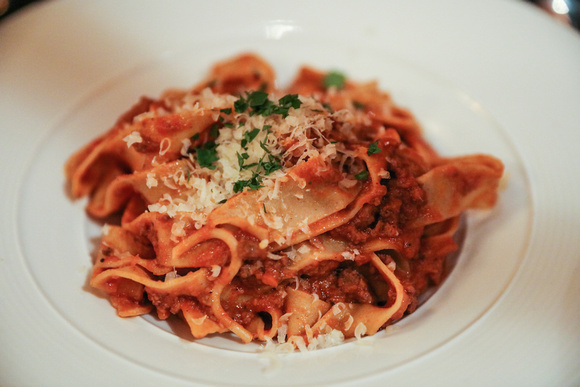 Wedding photography, a white plate with pasta bolognese.