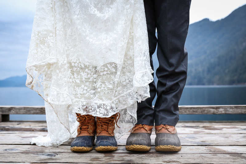 Wedding photography, a bride and groom wear duck boots on a dock in Washington.