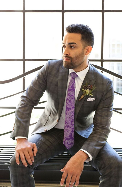 Groom models a Christopher Shafer Clothier suit. Navy and deep gray with purple tie