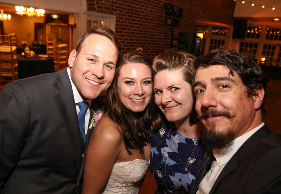 Kolleen and Bobby take an 'usie' or a selfie that includes the bride and groom