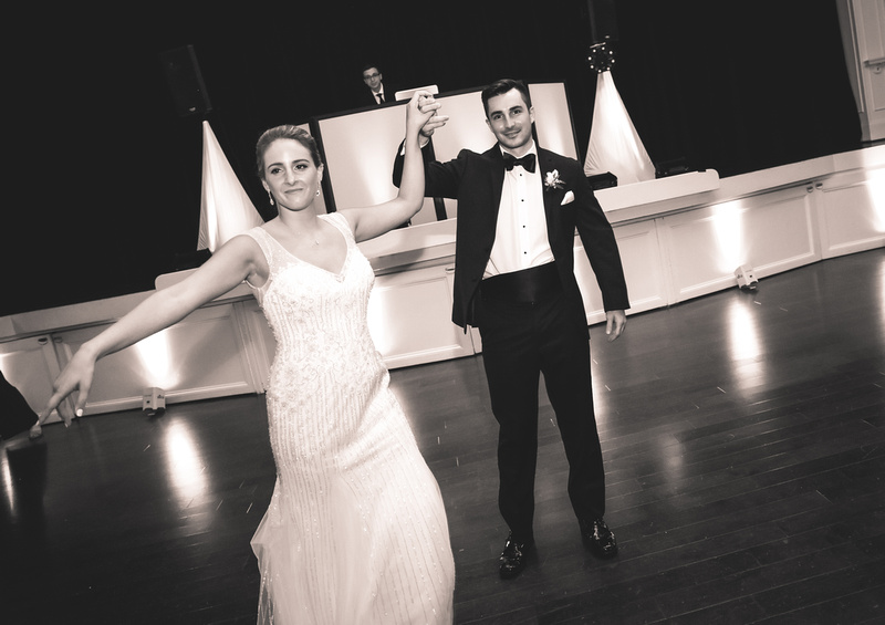 Wedding photography, a bride and groom show off some dance moves.
