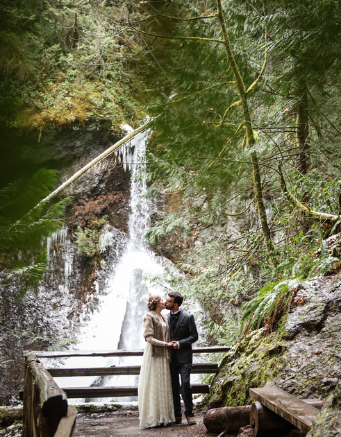 Epic hike sendoff, with the married couple kissing before a waterfall
