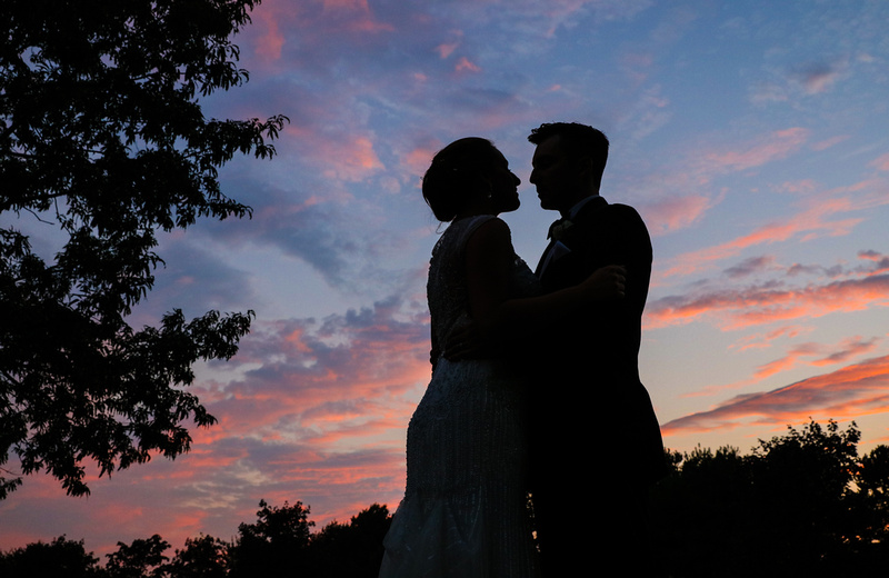 Wedding photography, a pink and blue sunset with two lovers in silhouette.