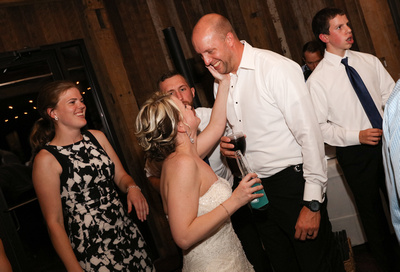 Wedding photography, the bride lovingly touches the grooms face on the dance floor.