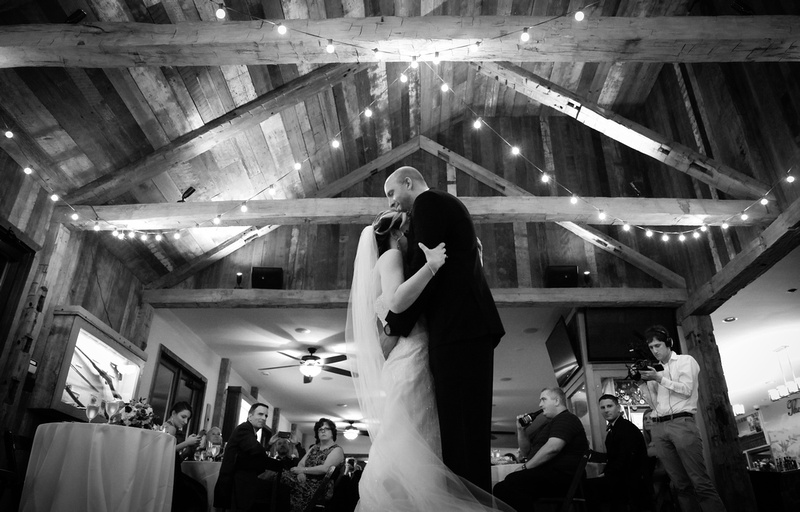 Wedding photography, the bride and groom embrace on the dance floor.