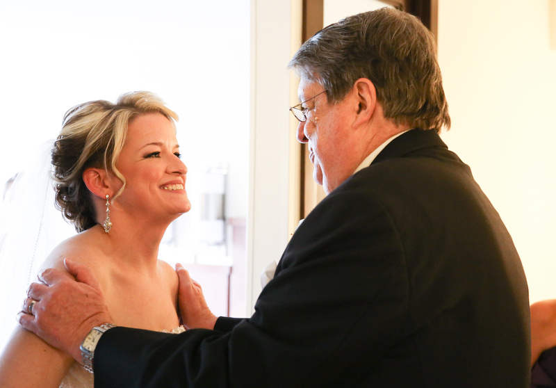 Wedding photography, a bride and her father share a look of love just before the ceremony.