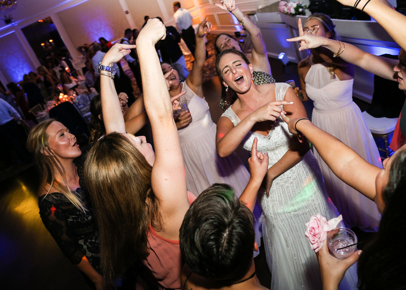 Wedding photography, the bride sings her heart out while surrounded by girlfriends.