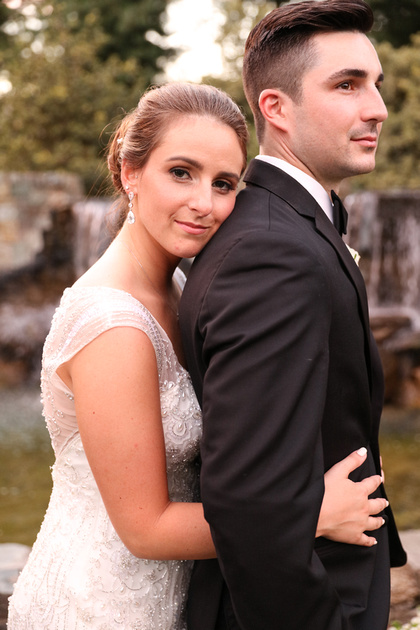 Wedding photography, a bride romantically rests her head on her groom's shoulder.