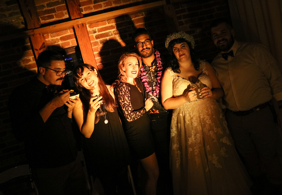 Wedding photography, a dark and shadowy image of the bride and her friends.