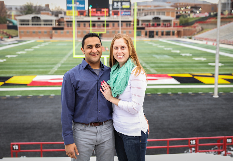 Engagement photography, a couple poses by the goal post on a college football field.