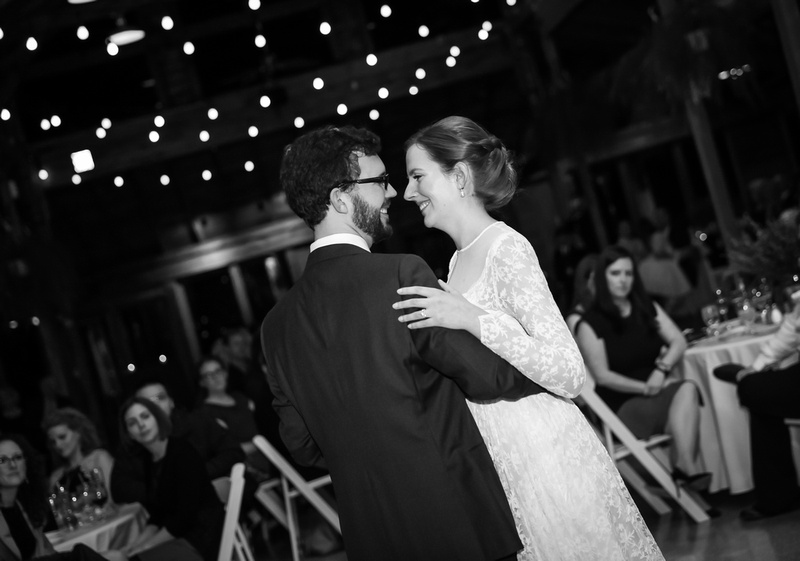 Wedding photography, a couple smiles while they share their first dance.