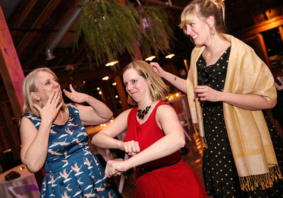 Wedding photography, a group of blonde woman dance and act silly.