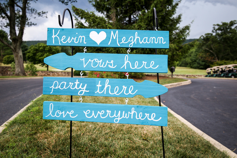 Wedding photography, a teal and white sign that welcomes wedding guests and tells where the day's event will happen.