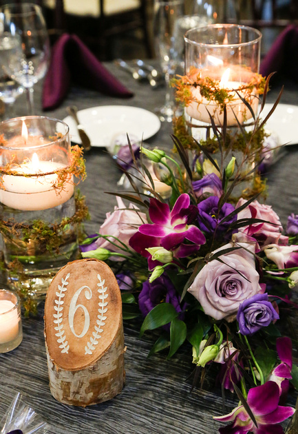 Wedding photography, a table setting with birch bark table numbers and purple florals.