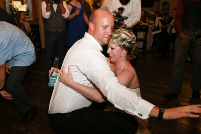 Wedding photography, the bride and groom dance all the way down to the dance floor.