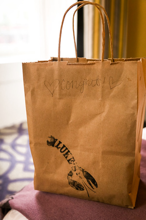 Wedding photography, a brown bag filled with lobster rolls.