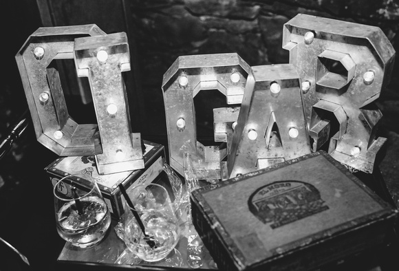 Wedding photography, a black and white image of CIGAR display letters and empty glasses.