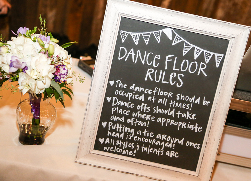 Wedding photography, a hand-made sign laying out the dance floor rules.