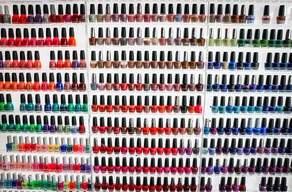 Wedding photography, a wall of colorful nail polishes.