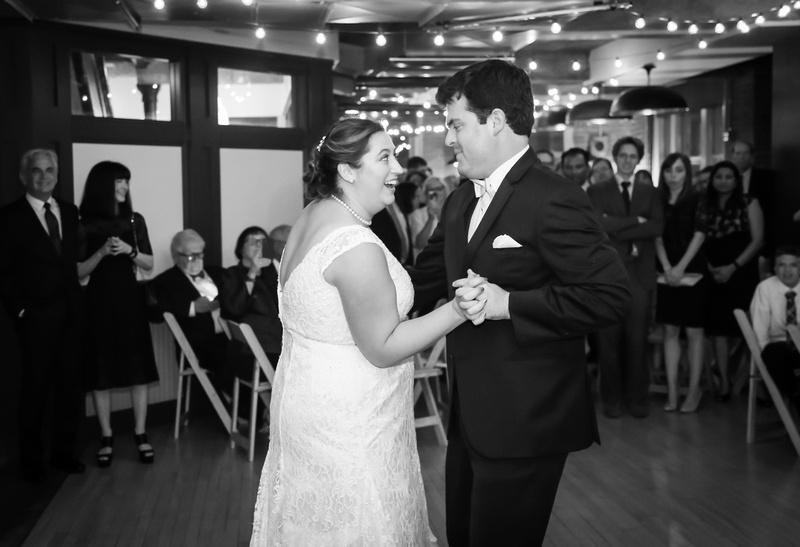 Wedding photography, a bride and groom dance playfully while their guests watch and smile.