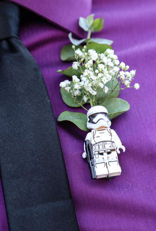 Wedding photography, a boba fett boutonniere pin with babies' breath.