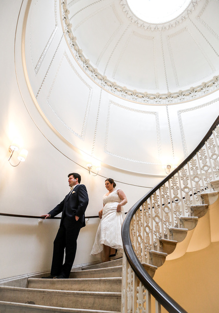 Wedding photography, a bride walk towards her groom on a epic staircase.