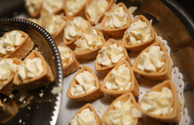 Wedding photography, a close up of pastries with white cream.