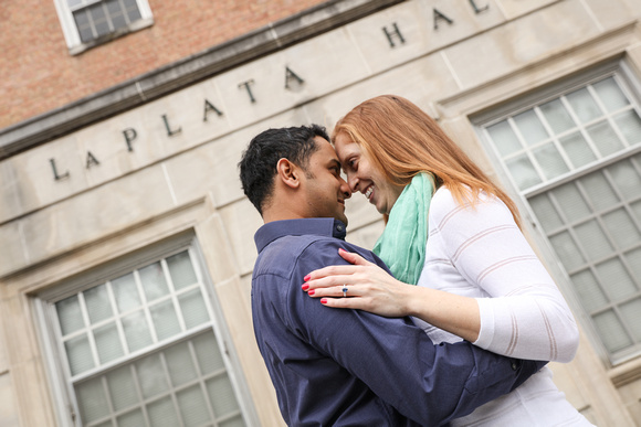 Engagement photography, a woman with red hair romantically looks at her fiancé.