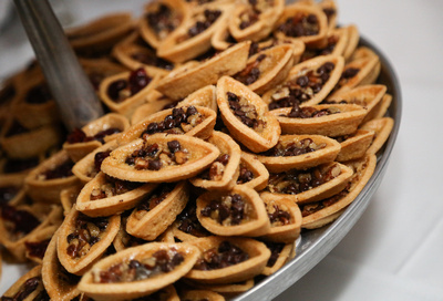 Wedding photography, a close up of mini gourmet pies.