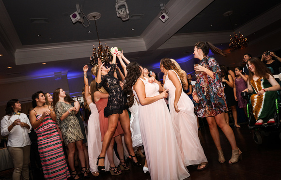Wedding photography, a group of girl jump for the bouquet.