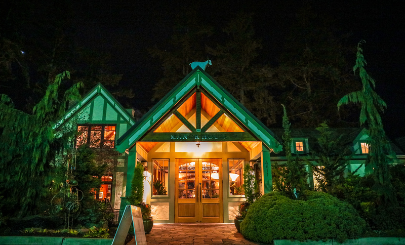 Wedding photography, a restaurant in the forest glows with green lighting.