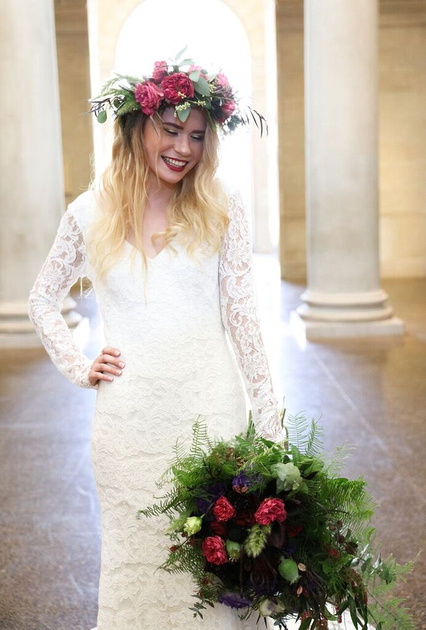 Smiling bride wearing the floral crown and holding flower bouquet at the styled wedding shoot by photos by kintz at the baltimore museum of art