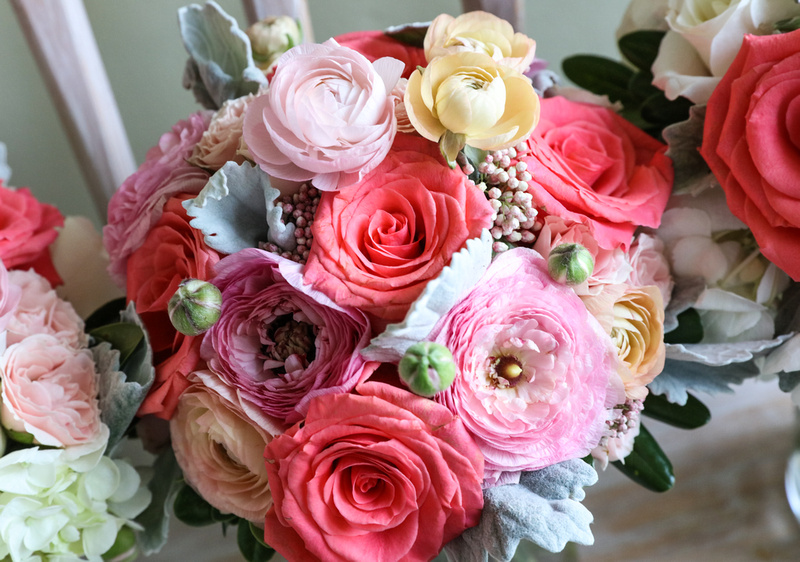 Wedding photography, a bright bouquet of pink, cream, and light green flowers.